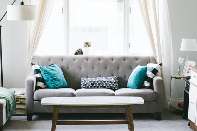grey sofa with blue cushions 1
